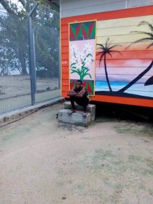 Abdul Aziz sits inside the fence at the Manus Island camp
