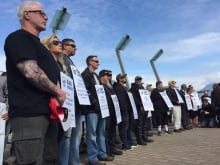 About 20 people met outside Windsor's Worker Safety Insurance Board office to protest the agency's handling of workplace injury claims.