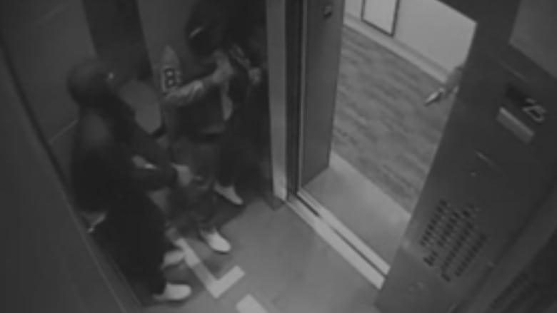 Two teens in an elevator