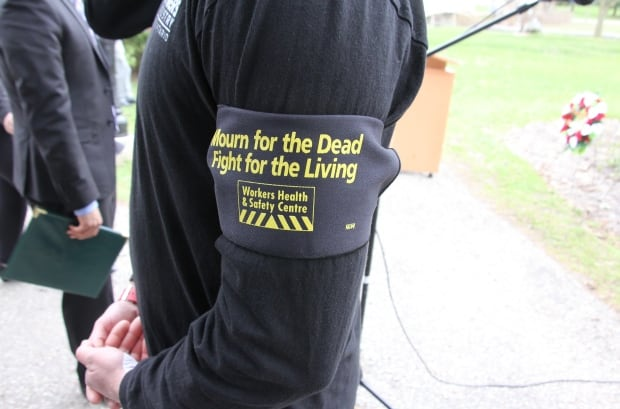 """Many on hand wore """"Mourn for the Dead"""" arm bands."""