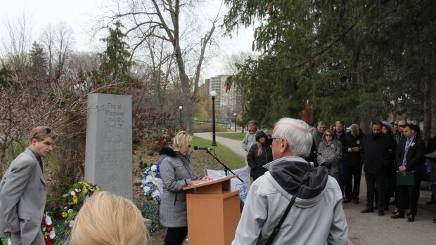 Tracey Mino speaks of her father Earl during a Day of Mourning Ceremony