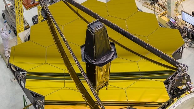 The giant gold mirror of the James Webb Space Telescope was unveiled on April 26, 2016, at NASA's Goddard Space Flight Center in Greenbelt, Md.
