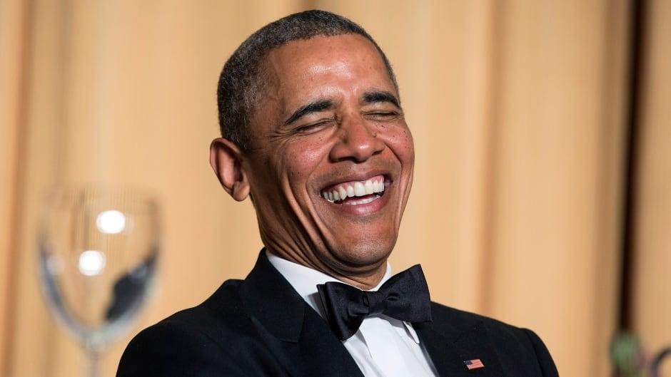 U.S. President Barack Obama cracks up during the White House Correspondents' Association Dinner in 2014.