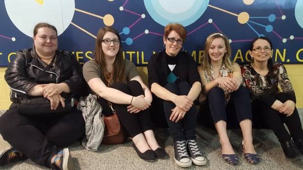 Cambrian College design students Manon Roussell, Maggie Hobbs, Johanna Westby (professor), Danielle Provencher and Darlene Benoit helped create the mural at Greater Sudbury's airport.