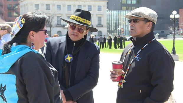 Sixties Scoop adoptees gathered for a rally on Parliament Hill on Friday.