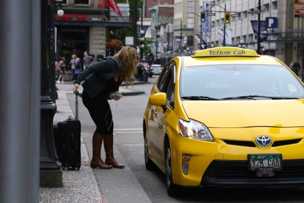 Passenger and Yellow Cab Taxi In Vancouver