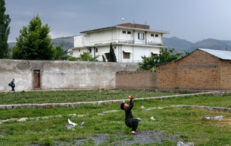 A boy plays in front of Osama bin Laden's compound in Abbottabad, Pakistan, in this May 5, 2011, photo, days after bin Laden was killed there by a U.S. Special Forces team.(Akhtar Soomro/Reuters)
