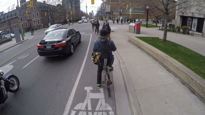 Metro Morning host Matt Galloway tests out a designated lane. (Matt Galloway/CBC) & More cyclists getting doored on city streets advocacy group says ...