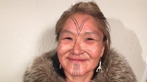 Millie Angulalik of Cambridge Bay, Nunavut, got traditional Inuit facial tattoos done last week in Kugluktuk by her niece Angela Hovak Johnston.