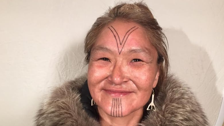 8e773d24f3d0f Millie Angulalik of Cambridge Bay, Nunavut, got traditional Inuit facial  tattoos done last week in Kugluktuk by her niece Angela Hovak Johnston.  (CBC)