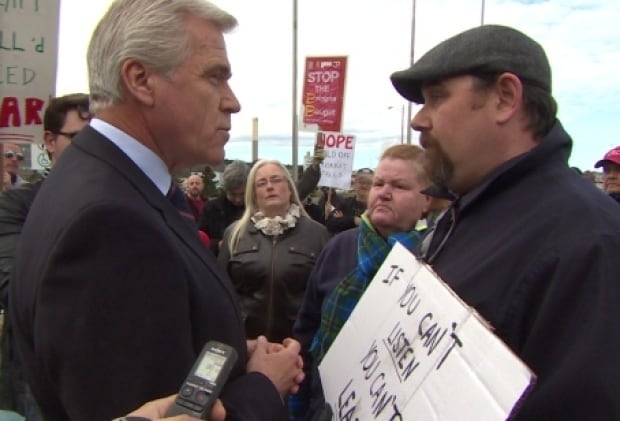 Dwight Ball faces protester CBC parking lot