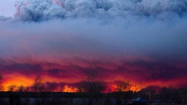 A plume of smoke hovers over Fort McMurray, Alta., during the height of the wildfire last May.