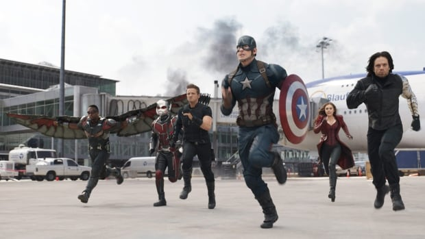 In this image released by Disney, Anthony Mackie, from left,  Paul Rudd, Jeremy Renner, Chris Evans, Elizabeth Olsen and Sebastian Stan appear in a scene from Captain America: Civil War.
