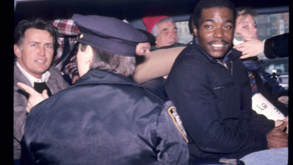 Martin Sheen and Daniel Berrigan (in red hat) arrested after a Martin Luther King Day protest in 1989.