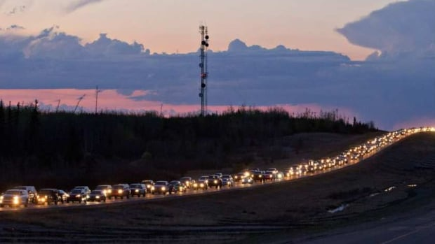 Traffic lines the highway as residents leave Fort McMurray on Tuesday May 3, 2016.