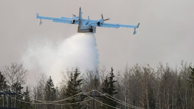 A water bomber drops its load on a fire south of Fort McMurray, Alberta last Friday. Prime Minister Justin Trudeau said Monday his government has turned down offers of assistance from foreign governments such as Russia, which last week offered to send water bombers and crews.