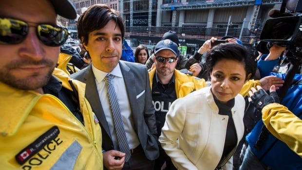 Former radio host Jian Ghomeshi, left, enters the court house with his lawyer Marie Henein on May 11, 2016.