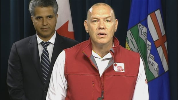 Conrad Sauve, president and CEO of the Canadian Red Cross, joined Alberta Premier Rachel Notley at a news conference announcing how donations will be dispersed to Fort McMurray evacuees.