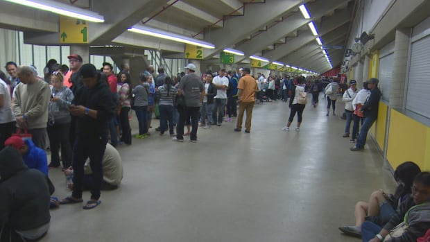 Crowds stretch through the Butterdome as Fort McMurray evacuees wait for government-issued debit cards.