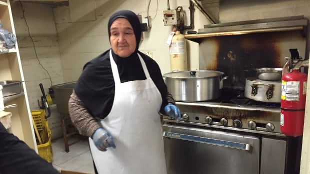 She's in charge! Zubaida Hageesa, a 73-year-old grandmother, led a group of Syrian refugee women in making a traditional meal at Butler's Pantry Wednesday as part of the Newcomer Kitchen project.