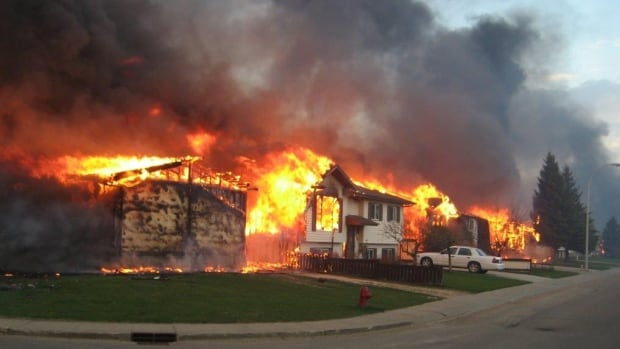 Homes along 12th Street in Slave Lake, Alta., burn in the wildfire of May 2011.
