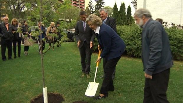 Manitoba Lt.-Gov. Janice Filmon plants the first Regal Celebration tree outside Government House in Winnipeg on Thursday.