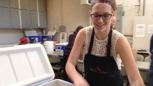 Marlyne Vanderlee helps pack up the sandwiches in coolers