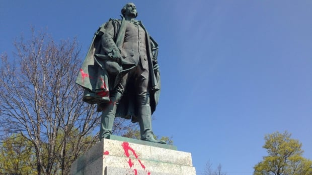It's not clear when the statue was hit, but paint splashes were noticed on it Friday morning.