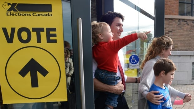Liberal leader Justin Trudeau and family leave a polling station after voting in Montreal, Quebec on Monday, Oct. 19, 2015.