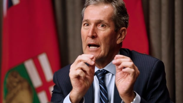 Manitoba Premier Brian Pallister speaks to media at an embargoed press conference before the provincial throne speech at the Manitoba Legislature in Winnipeg, Monday, May 16, 2016.