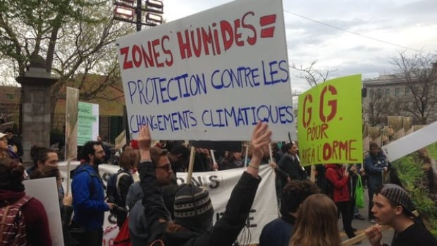 Several hundred people demonstrated against the L'Anse-à-l'Orme development project in front of City Hall on Monday.