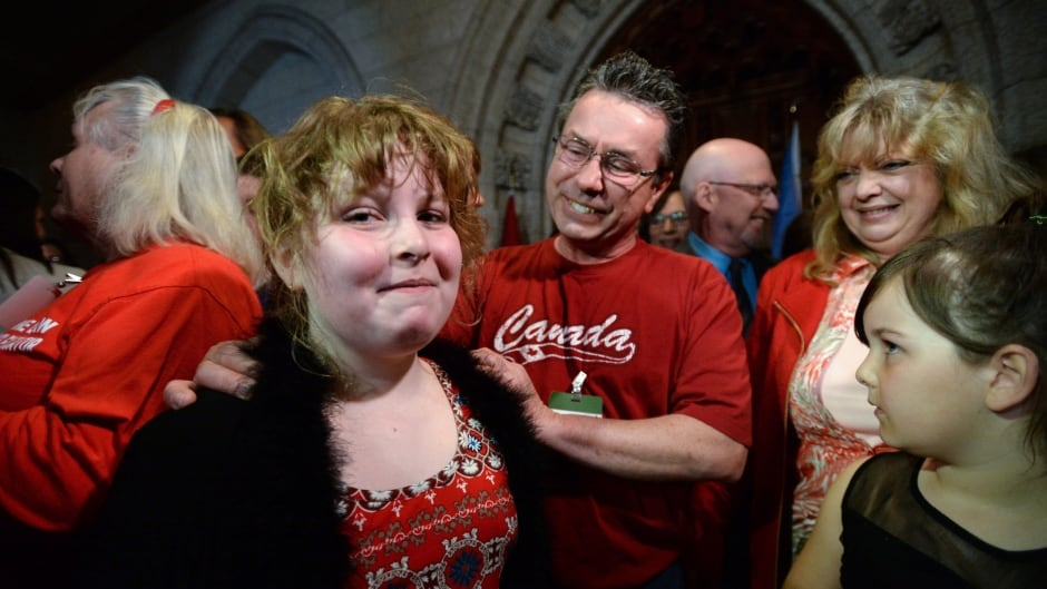 Charlie Lowthian-Rickert, 10, who is transgender, is comforted by her parents after speaking on Parliament Hill about legislation intended to protect her gender identity and gender expression.