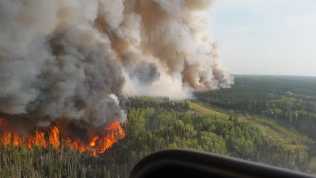 An aerial view of the flames roaring north of Fort McMurray on Tuesday afternoon.