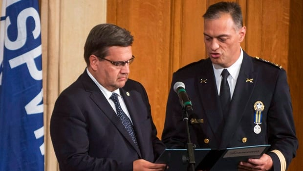 Mayor Denis Coderre, left, swears in Philippe Pichet as the new Montreal Chief of Police at City Hall on Friday, August 28, 2015.