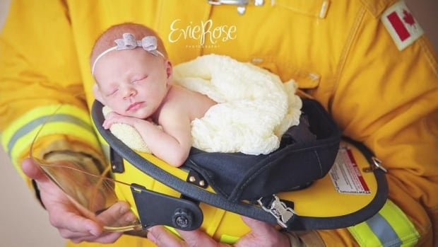 Brielle Brunet was born a day after her parents evacuated Fort McMurray. Her newborn photoshoot is a nod to the firefighters that remain in the city.