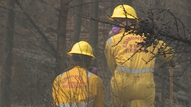 While firefighters continue to work on hot spots along Highway 63, the province has announced a tentative plan for when Fort McMurray residents can begin returning home.