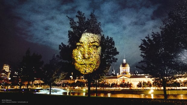 This is one of the giant projections from Cité Mémoire, a project to evoke Montreal history created by Michel Lemieux and Victor Pilon as part of the 375th anniversary celebrations coming next year to Montreal.