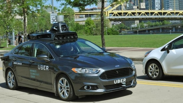 An Uber driverless-car prototype navigates Pittsburgh in May.