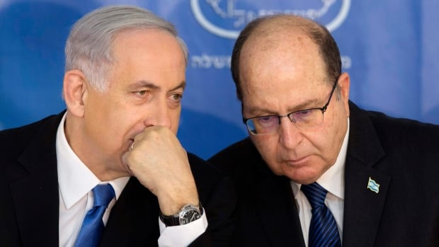 A website claimed former Israeli defence minister Moshe Yaalon, seen here at right with Israeli Prime Minister Benjamin Netanyahu in February 2015, had made nuclear threats against Pakistan. Pakistan's defence minister apparently thought the fake news report was real.