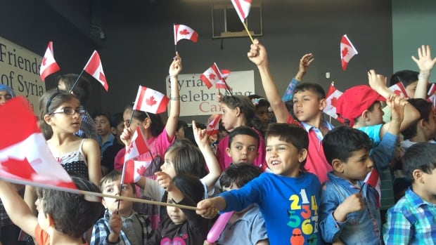 Young Syrian refugees sing O Canada at an event in Toronto.