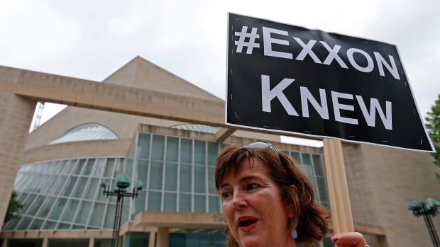 Activist Danna Miller Pyke protests across from Morton H. Meyerson Symphony Center where the Exxon Mobil annual shareholder meeting took place Wednesday in Dallas, Texas.