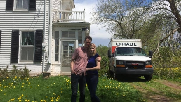 Todd MacLean and Savannah Belsher-MacLean in front of their new house in Hazelbrook, which they plan to rent out on Airbnb.