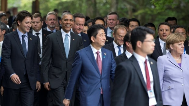 From left, Prime Minister Justin Trudeau, U.S. President Barack Obama, British Prime Minister David Cameron, Japanese Prime Minister Shinzo Abe, European Council President Donald Tusk, Italian Prime Minister Matteo Renzi, and German Chancellor Angela Merkel walk to a tree planting ceremony as they visit the Ise Jingu shrine in Ise, Mie Prefecture, Japan, on Thursday.
