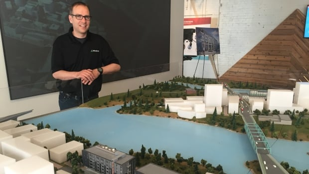 Rodney Wilts, a partner with Windmill Developments, stands with a model of the company's Zibi project at its sales centre.