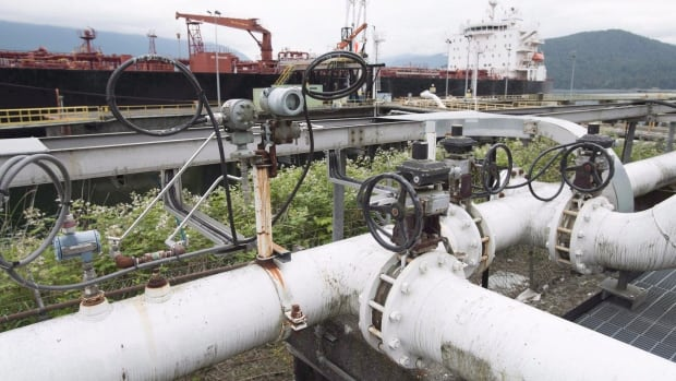 A ship receives its load of oil from the Kinder Morgan Trans Mountain Expansion Project's Westeridge loading dock in Burnaby, British Columbia, on June 4, 2015. Kinder Morgan's plan to expand an oil pipeline from Alberta to Burnaby has received conditional approval from the National Energy Board.