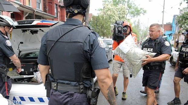 A Toronto marijuana dispensary is raided by police last May.