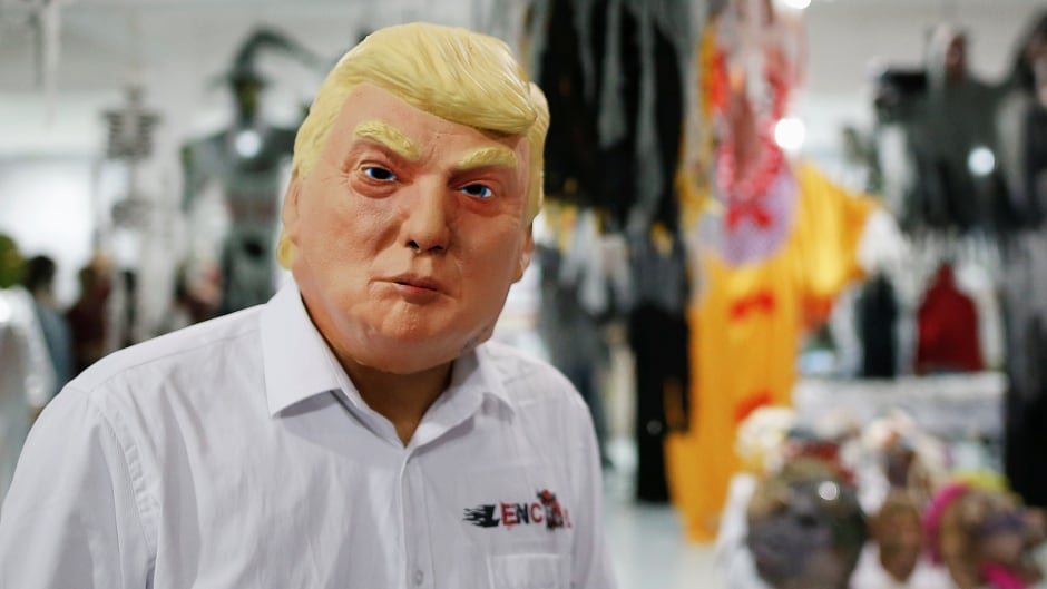 A person wearing a Donald Trump mask,  fresh off the factory floor, in China.