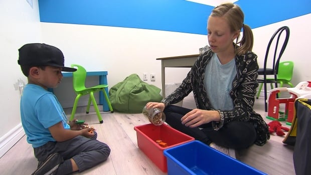 Saif Ullah, 4, who has autism, plays with his ABA therapist, Meghan Turnbull at ASD Montreal, a private clinic.