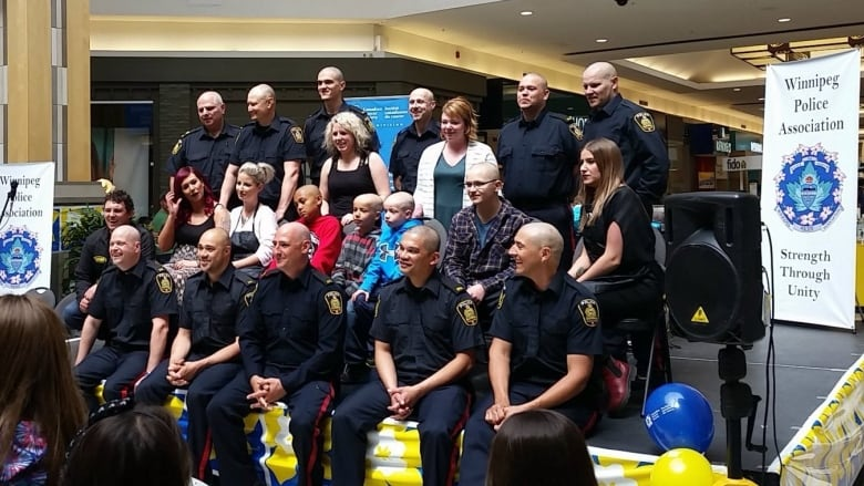 Winnipeg police chop locks off for cancer research | CBC News