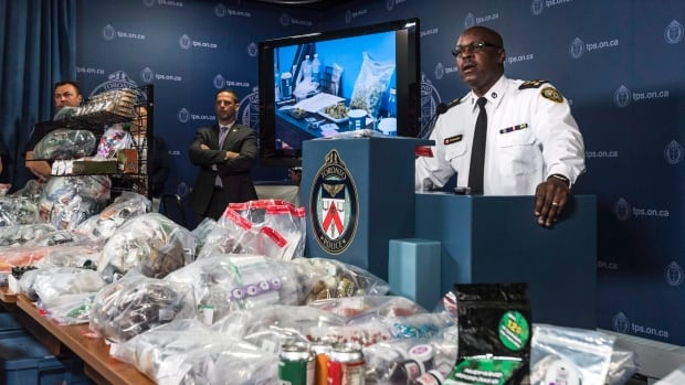 Toronto Police Chief Mark Saunders, surrounded by marijuana products including edibles and oils, speaks during a press conference a day after the Project Claudia raids in May, 2016.